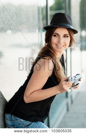 Smiling Girl With Digital Camera Flirts