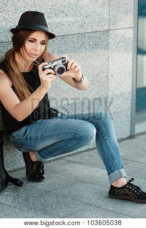 Girl  Photographs With Retro Styled Digital Camera.