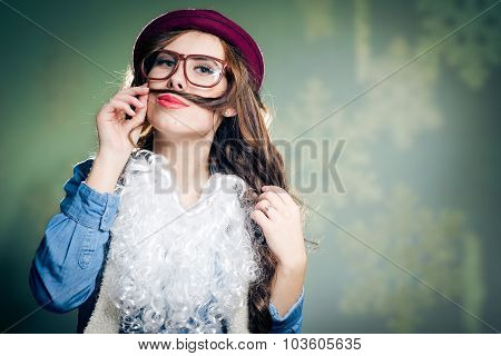 funny hipster lady in super size eyeglasses wearing  santa hat