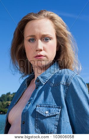 Portrait Of Serious Young Woman In Denim Shirt