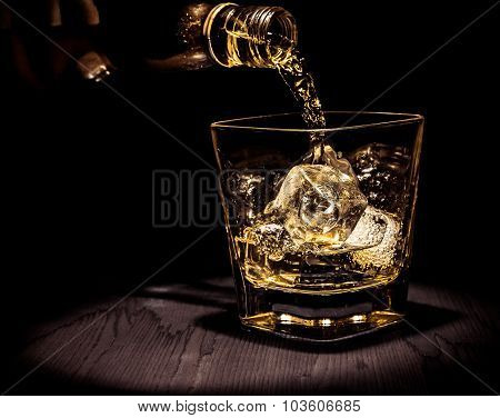 Barman Pouring Whiskey In The Glass On Wood Table, Warm Atmosphere, Old Style, Time Of Relax With Wh