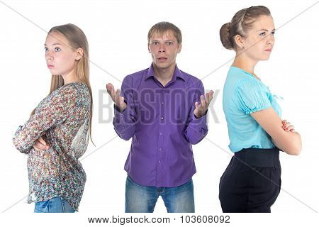 Confused Blond Man And Two Young Women