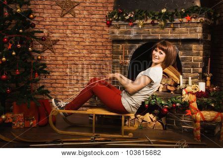 Woman Posing By The Fireplace
