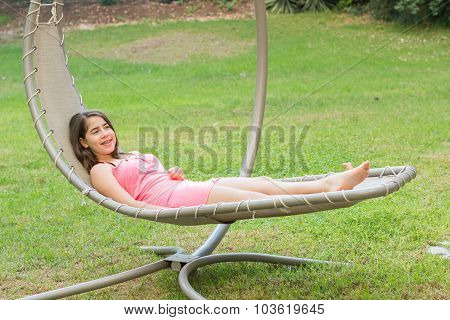 Teenage Girl Enjoying An Outdoor Hammock