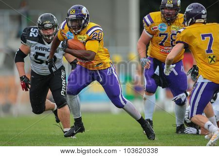VIENNA, AUSTRIA - JULY 13, 2014: RB Islaam Amadu (#20 Vikings) runs with the ball during an Austrian football league game.