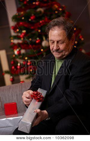 Senior Man Wrapping Christmas Present