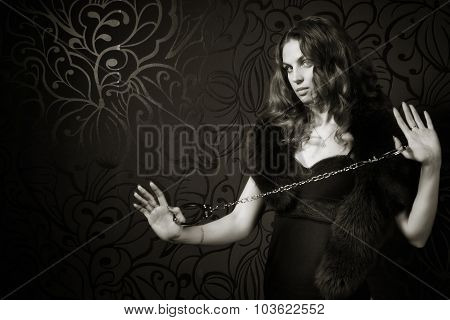 Woman In A Luxurious Lingerie With Handcuffs