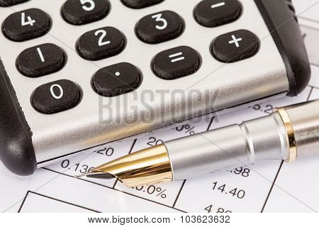 Calculator And Pen On  Business Reports