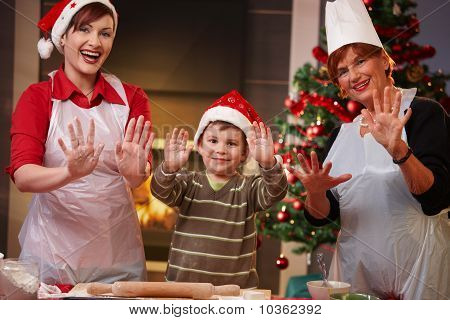 Happy Child With Mom And Grandmother At Christmas