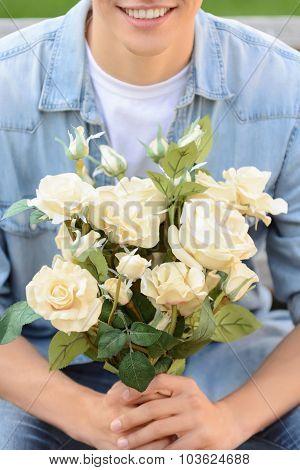Positive boy holding flowers