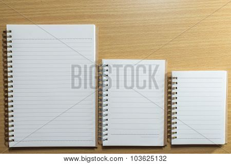 Diary And Book On Wooden Table. Top View