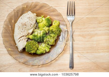 Steamed Chicken Fillet With Brussels Sprout On A Plate Horizontal Top View With A Fork And Upon A Wo