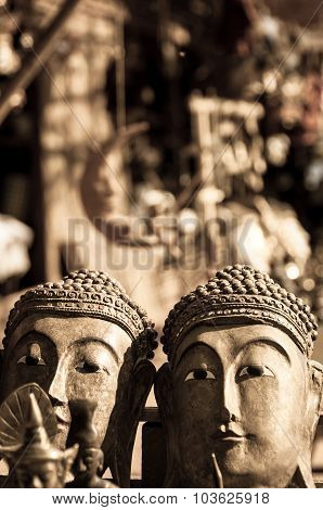 Two buddha heads in sepia