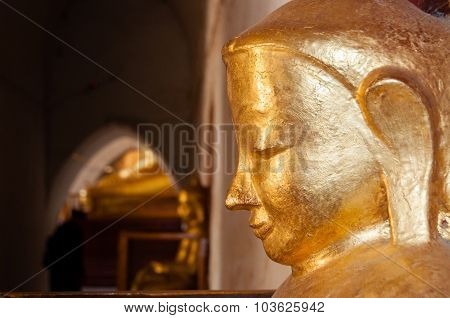 Buddha face gold statue side