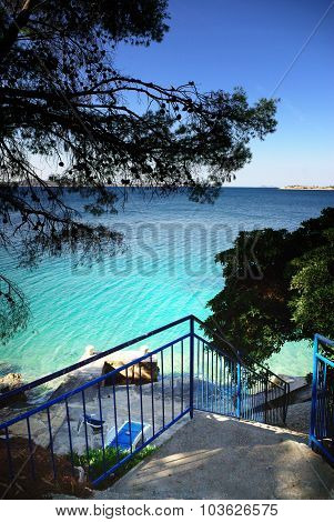 Stairs To The Beach, Clear Water And Blue Sky In Croatia Dalmatia