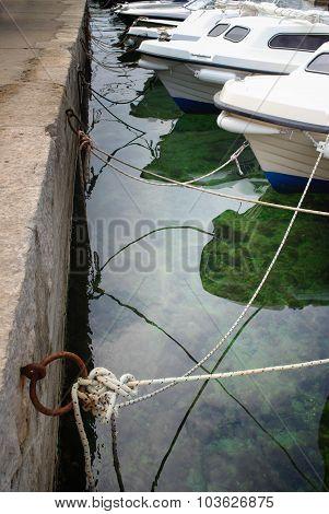 Boats Moored To The Stone Coast, Croatia