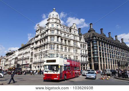 London City Tour Bus Passing Parliament Square