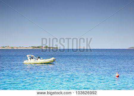 Small Motorboat Moored In A Clean Warm Sea, Croatia Dalmatia