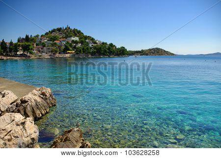 Rocky Beach In The Bay Turquoise Sea, Croatia Dalmatia