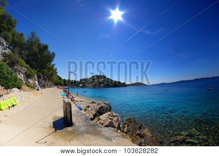 Rocky And Concrete Beach With Shower In The Bay Turquoise Sea, Croatia