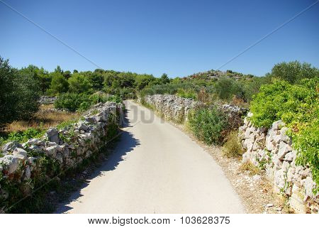 Narrow Winding Asphalt Road Between The Rocks, Croatia Dalmatia