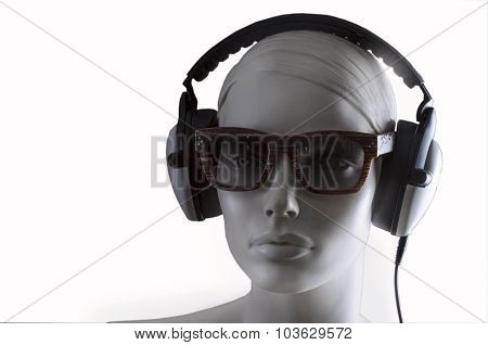 mannequin with glasses and headphones