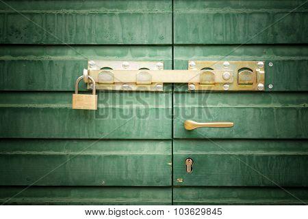Golden Padlock And Handle On Green Door, Detail