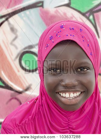 Young Muslim girl wearing a pink headscarf, ten years old