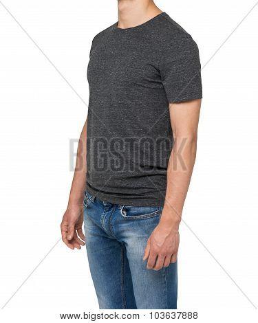 Side View Of A Man In A Dark Grey T-shirt And Denims. Isolated On White.