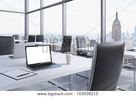 Workplaces In A Modern Corner Panoramic Office In Manhattan, New York City. White Tables And Black C