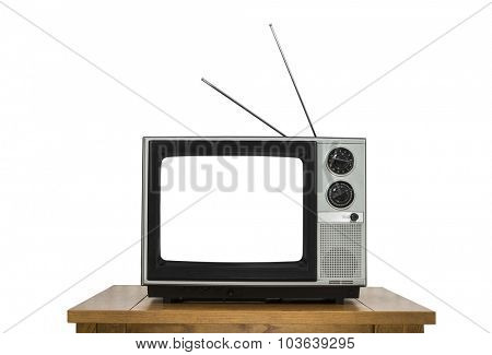 Vintage television on wood table isolated on white with cut out screen.