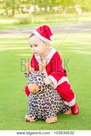 Asian Baby  In Santa Claus Suit