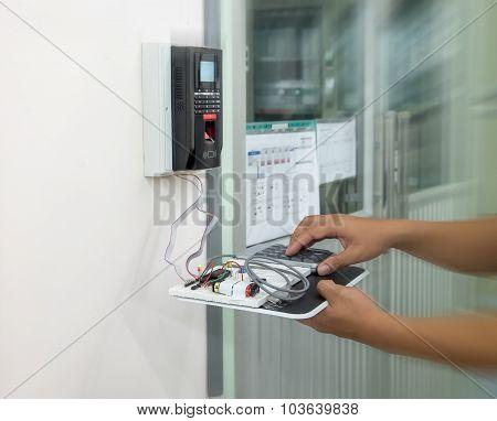 hacker is hacking finger scan machine
