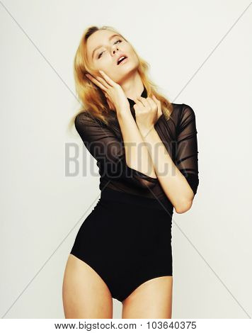 fashion blond woman model posing in studio