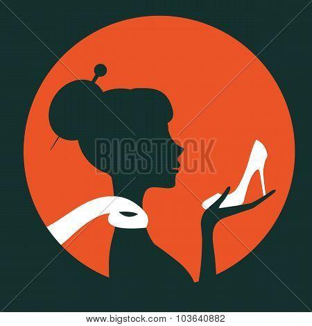 Beautiful elegant woman silhouette holding a shoe