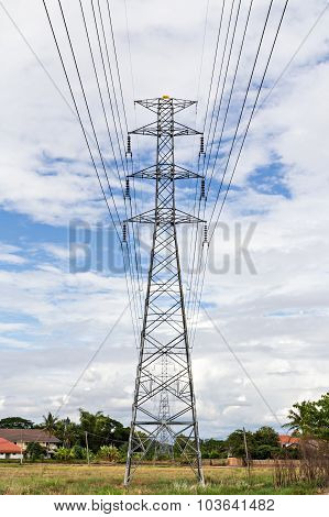 High Voltage Post.high-voltage Tower On Blue Sky