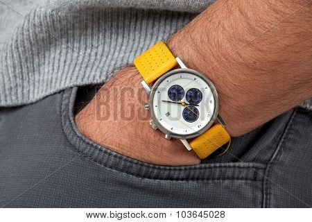 Close up of a man's hand with a watch