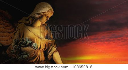 Golden Angel On The Background Of Red Sky (antique Statue)