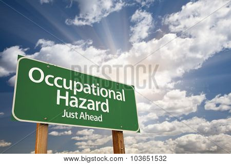 Occupational Hazard Green Road Sign With Dramatic Clouds and Sky.