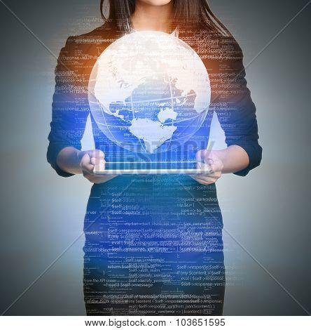 Close up Girl holding a digital globe over tablet