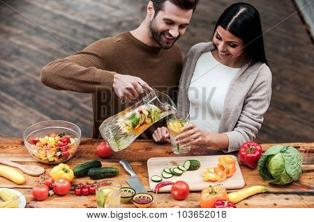 Young Couple Enjoying Healthy Food And Drinks