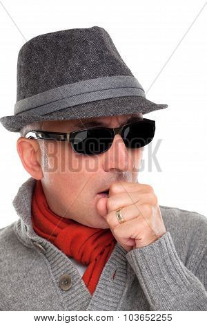 Elegant man coughing