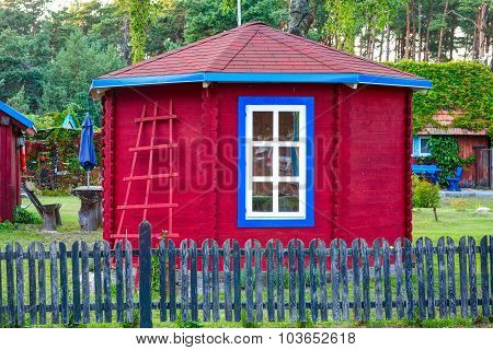 Red vintage outhouse. Lithuania