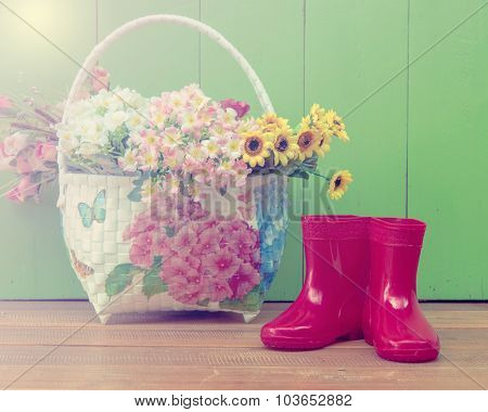 Red Color Children Boot And Flower Basket Put On The Wood Floor