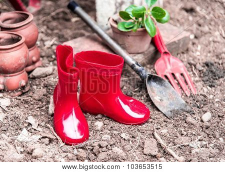 Gardening Tool Including By Red Boots Vase , Fork , Shovel And Barrow , Vintage Color Tone Effect