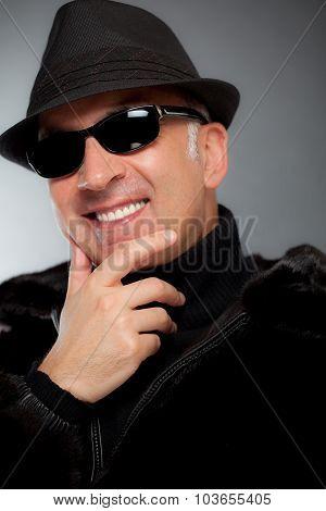 Elegant man wearing shades and Elegant man wearing sunshades and a hata hat