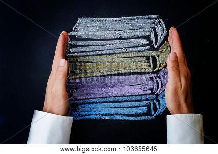 Man's Hands Holding A Stack Of Books Drawn With Chalk