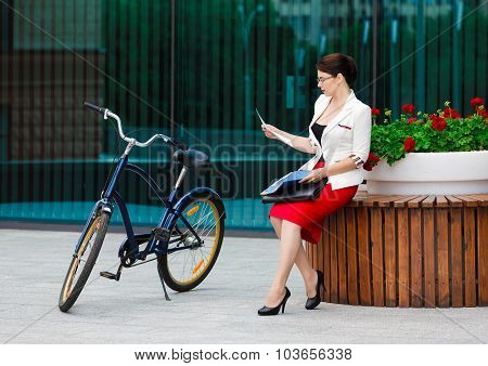 Young Elegant Business Woman With Bicycle