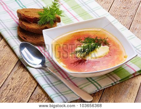 soup of cabbage with Meat, Sour cream and Fennel in a plate on a napkin from flax with rye bread