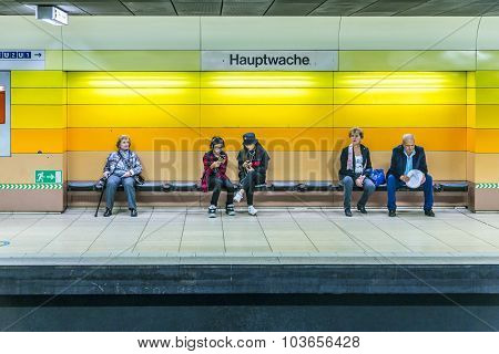 People Waiting At A Bench In The Subway Station Hauptwache